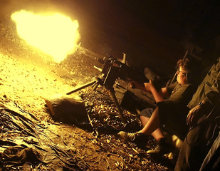 Boy fires Mag 58 automatic weapon at machine gun shoot.