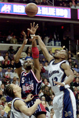 ROCKETS MOBLEY CUTTINO SHOOTS THE BALL AS WIZARDS LUE DEFENDS.