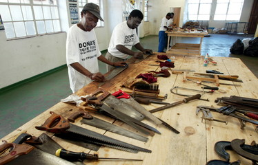 SOUTH AFRICAN JOB SEEKERS REPAIR DISCARDED TOOLS.