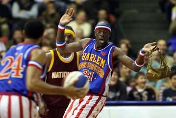 Kevin Daley of Harlem Globetrotters holds a bag he took from a spectator during their game with NY Nationals in Istanbul