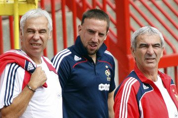 France's national soccer coach  Domenech , assistant Mankowski and Ribery enter the field during a visit of Marakana stadium in Belgrade