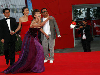 Actress Tan throws a toy as she arrives at the closing ceremony of the 66th Venice Film Festival
