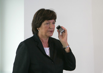 German Health Minister Schmidt uses her cell phone before a weekly cabinet meeting in Berlin