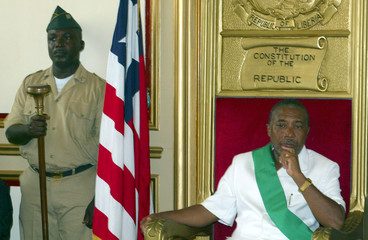 LIBERIA'S TAYLOR LISTENS TO SPEECHES AT HANDOVER CEREMONY IN MONROVIA.