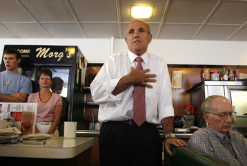 Former mayor of New York City and Republican presidential candidate Giuliani speaks to patrons at Morg's Diner during a campaign stop in Waterloo