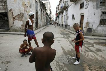 Kids play on the street in Havana