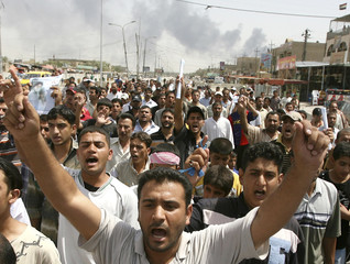 People protest yesterday's car bomb that police said killed 17 people and wounded 25 others outside a restaurant in a Shi'ite neighbourhood in southern Baghdad