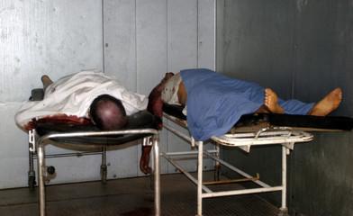 Bodies of Iraqi men lie in hospital morgue after gunmen shot them in Baghdad.