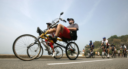 Residents ride their bicycles along Leblon beach to celebrate the International Car Free Day in Rio de Janeiro