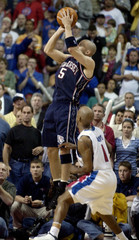 NETS JASON KIDD SHOOTS GAME WINNING BASKET AGAINST DETROIT PISTONS.