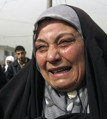 An Iraqi woman weeps during the funeral of a relative who was gunned down in Baghdad