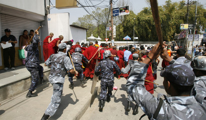 Police charge protesting monks and others near the Chinese Embassy visa section office in Kathmandu