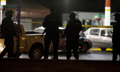 Federal policemen guard a crime scene after a shooting in Monterrey