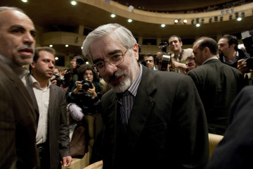 Former Iranian Prime Minister and reformist candidate for Iranian presidential elections Mirhossein Mousavi arrives for a meeting with supporters in Tehran