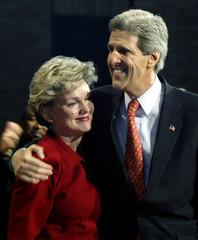 DEMOCRATIC PRESIDENTIAL CANDIDATE JOHN KERRY HUGS MICHIGAN GOVERNOR.
