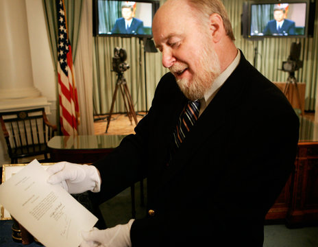 Curator holds a letter with handwritten notes by former US President John F Kennedy at the John F. ...