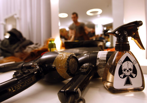 Hair dryers and lotions lie on a table backstage of the Etro Fall/Winter women's collection 2008/09 during Milan Fashion Week
