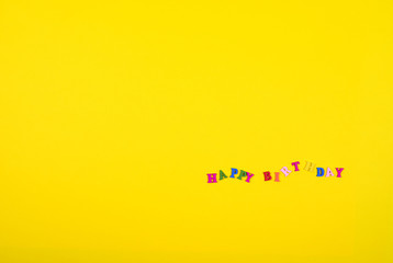 Yellow background with an inscription happy birthday