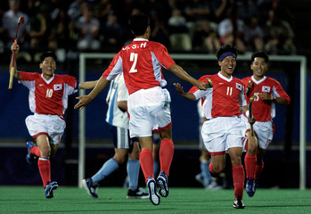 SOUTH KOREAN PLAYERS CELEBRATE GOAL AT OLYMPIC HOCKEY.