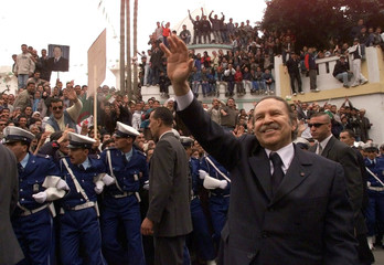 Algerian President Abdelaziz Bouteflika greets a huge crowd March, 14, 2002 as he visits the Wilaya ..