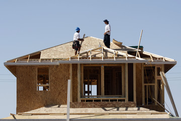 File image of workers on rooftop in Gilbert, Arizona