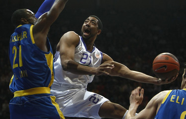 Real Madrid's Jeremiah Massey tries to drive the ball past Maccabi Tel Aviv's  D'or Fisher during their Euroleague men's basketball game in Madrid