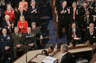 Democratic presidential candidate Senator Clinton and Senator Obama while U.S. President George W. Bush delivers the final State of the Union address