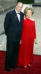 French President Jacques Chirac and his wife Bernadette wait for [Britain's Queen Elizabeth II] at t..