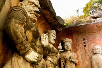 Big stone Buddha on the stone wall at Wuxi Yuantouzhu - Taihu scenery garden, China