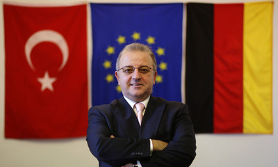 Kolat, head of Turkish community in Germany poses after an interview in Berlin