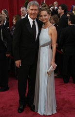 Actors Calista Flockhart and Harrison Ford arrive at at the 80th annual Academy Awards in Hollywood