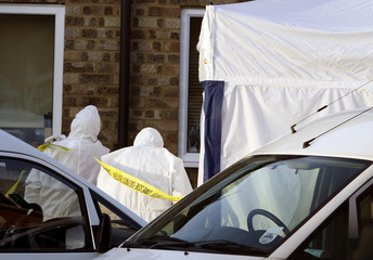 Police forensic officers enter house in Trimley St. Martin near Ipswich