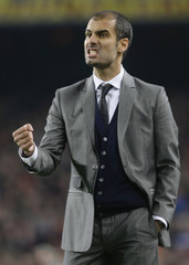 Barcelona's coach Guardiola gestures during their Champions League soccer match against Inter Milan in Barcelona