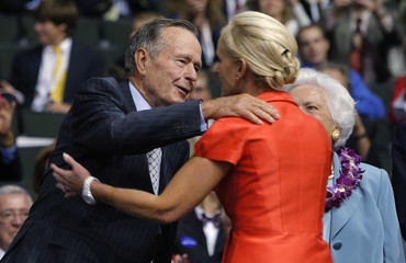 Former US President Bush hugs Cindy McCain at the second session of the 2008 Republican National Convention in St. Paul