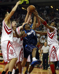 Mavericks Daniels battles Houston Rockets for rebound during first half action in Game Six.