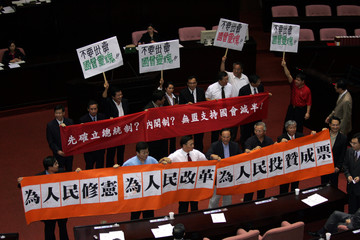 Taiwan lawmakers celebrate the passage of a bill in Taipei.