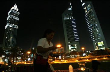 Waitress serves at Ziara Ramadan tent near the Emirates towers in Dubai