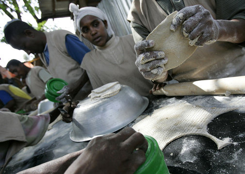 "Ethiopian people prepare ""matzah"" or unleavened bread in Gondor"