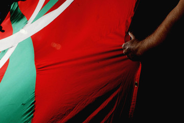 A demonstrator grips a giant Basque flag during a pro-independence march in Pamplona