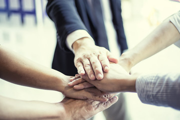 people showing unity with their hands together, teamwork and together concept