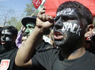 Indian men shout slogans during protest against US President Bush in New Delhi