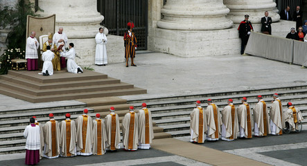 Newly elevated cardinals stand in line to receive their rings from Pope Benedict XVI during a specia..