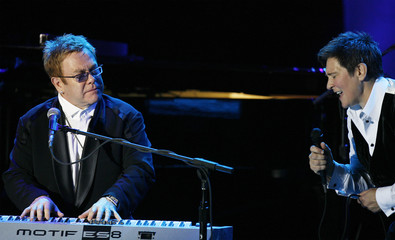 "Musician Elton John performs with K.D. Lang during the ""An Enduring Vision"" benefit for the Elton John AIDS foundation in New York"
