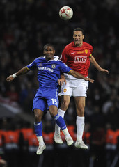 Manchester United's  Ferdinand challenges Chelsea's  Malouda during their UEFA Champions League final soccer match at the Luzhniki stadium in Moscow