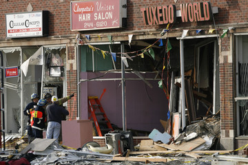 Rescue workers survey the scene of an explosion in Waukegan, Illinois