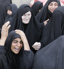 Women grieve during a funeral in Kerbala of people found buried in a mass grave