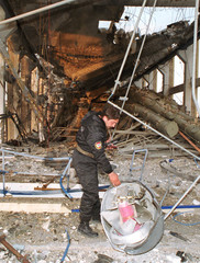 LEBANESE CIVILIAN DEFENCE INSPECTS THE REMAINS OF AN ISRAELI MISSILE IN DIER AMAR POWER STATION.