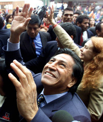 Peruvian presidential candidate Alejandro Toledo and his Belgian wife Eliane Karp wave to supporters..