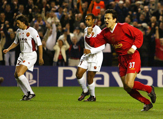 LIVERPOOL'S LITMANEN CELEBRATES SCORING AS AS ROMA'S EMERSON ANDCANDELA WALK AWAY AT ANFIELD.
