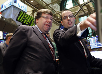 Trading specialist Gallagher shows Ireland's PM Cowen information on his trading computer, on the floor of the New York Stock Exchange